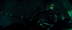 Batman looks down on Superman with the Kryptonite spear