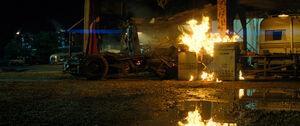 Superman and Batman stand on the Batmobile