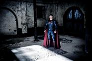 Superman stands in Wayne Manor