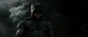 Batman mourning Superman