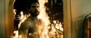 Clark walking through fire