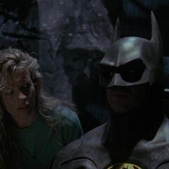 Vicki and Batman in the Batcave.