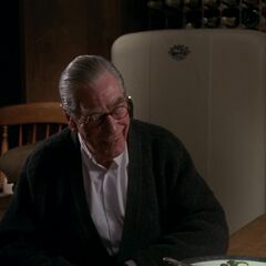 Alfred talks with Vicki Vale.