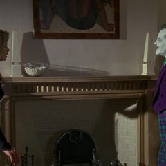 The Joker visits Vicki in her apartment.