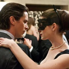 Bruce Wayne dances with Selina Kyle.