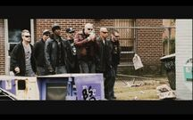 Darley Gang walking down a street