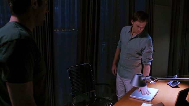 File:Dexter at his desk.png