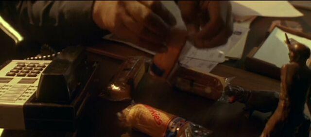 File:Powell Openning Twinkies, Die Hard 2.jpg