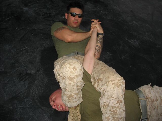 File:Armbar Technique - MCMAP.jpg