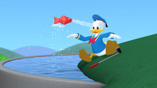 File:Red fish squirts at donald.jpg