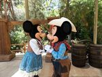Disneyland Mickey and Minnie kiss as cowboys
