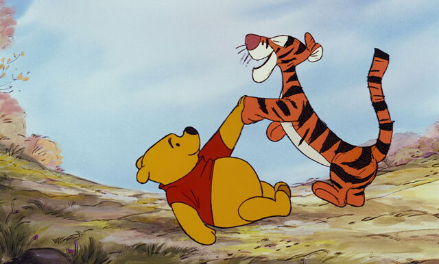 File:Tigger is shakeing Pooh Bear's paw again.jpg