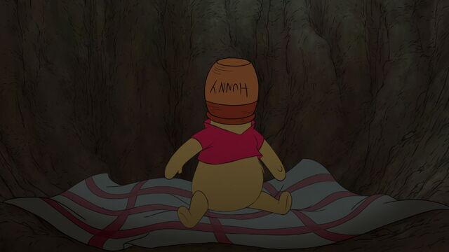 File:Winnie the Pooh has got the honey pot stuck on his head again.jpg