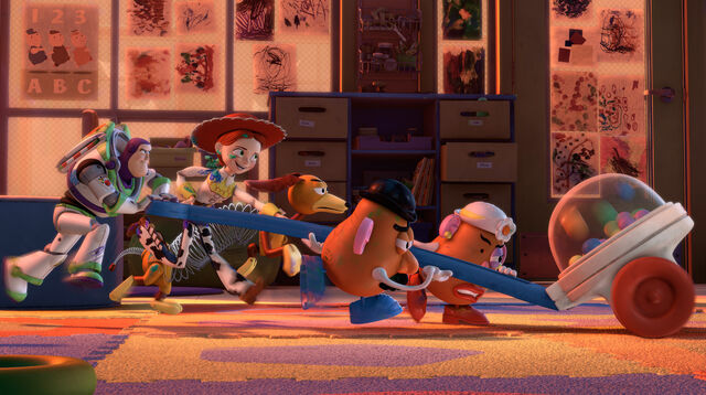File:Woody's Gang Working Together Toy Story 3.jpg