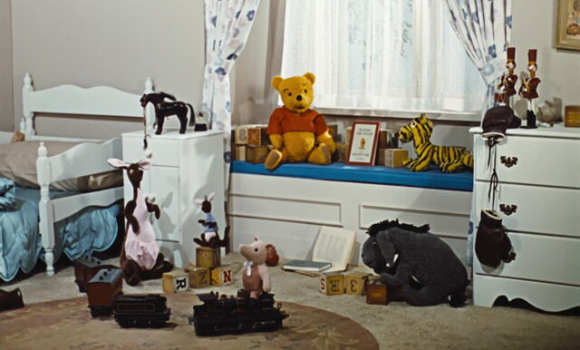 File:Winnie the Pooh and his friends are stuffed toy animals in Christopher Robin's bedroom.jpg