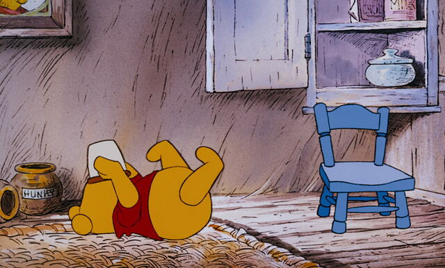 File:Winnie the Pooh is trying to get the last bit in the honeypot.jpg