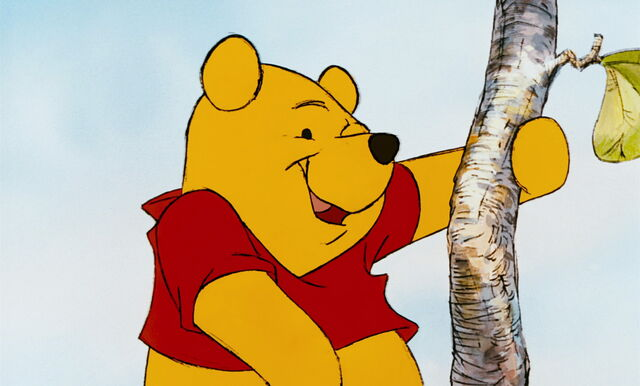 File:Winnie the Pooh is exited to get to the top of the honeytree.jpg