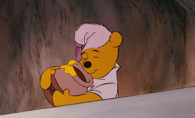File:Winnie the Pooh has his honey pot in his paws.jpg