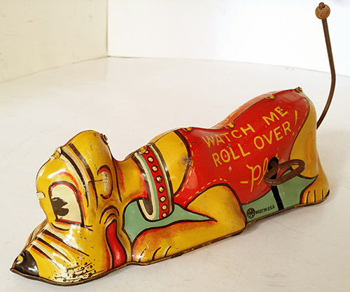 File:Pluto windup rollover toy.JPG