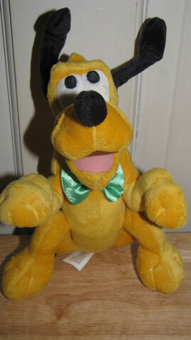 File:Walt Disney World Tagged Pluto Begging for His Bone in Green Bow Tie.jpg