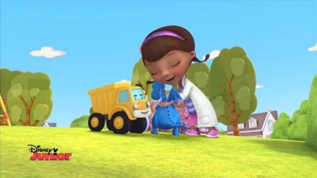 File:Doc and toys hug.jpg