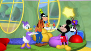 Mickey, goofy and daisy hold up toy marchers