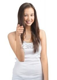10885696-portrait-of-cheerful-casual-girl-pointing-and-smiling-isolated-on-white-background
