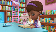 Doc and lambie looking at the book