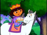 Dora bringing the cake