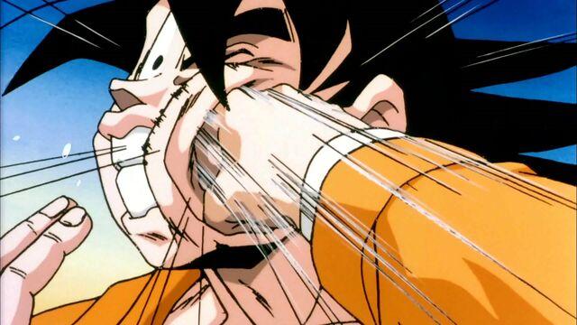 File:Krillin Sucker Punches Goku.jpg