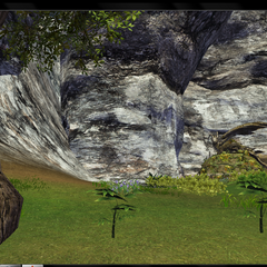 One entrance to Fungal's hidden cave to the left between the rocks.