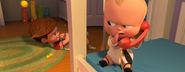 Boss Baby whispering into phone