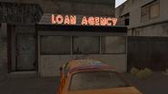 LoanSharkMedium-DPL-TalkingToGuyInBooth
