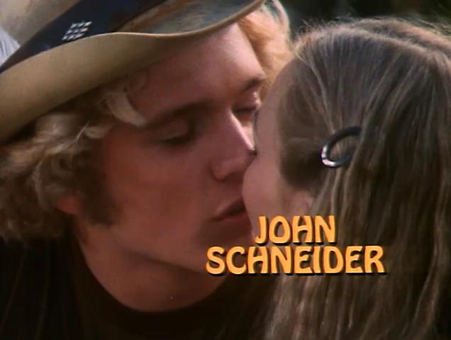 File:John Schneider - Title Card.png