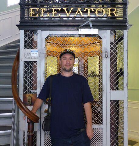File:Me by 1898 Titan elevator .jpg