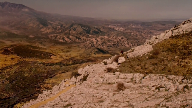 File:Ojo and Dorothy travel over mountains.png