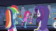 Pinkie Pie holding up a guitar EG2
