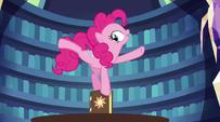 Pinkie Pie balanced on top of the book EG2