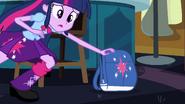 Twilight picking up her backpack EG