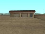 Depósito-taller de reparación gasolinera Come-A-Lot
