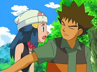 Archivo:EP550 Brock parando a Maya.png