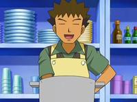 Archivo:EP553 Brock cocinando.png
