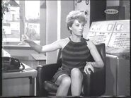 The receptionist - an icy bad girl (Yolande Turner)