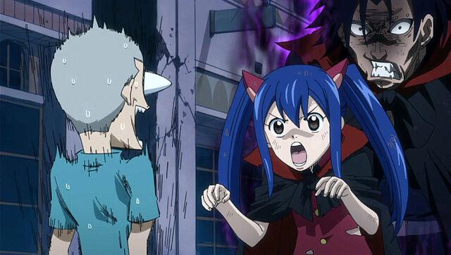 File:Gajeel helps Wendy scare a kid.jpg