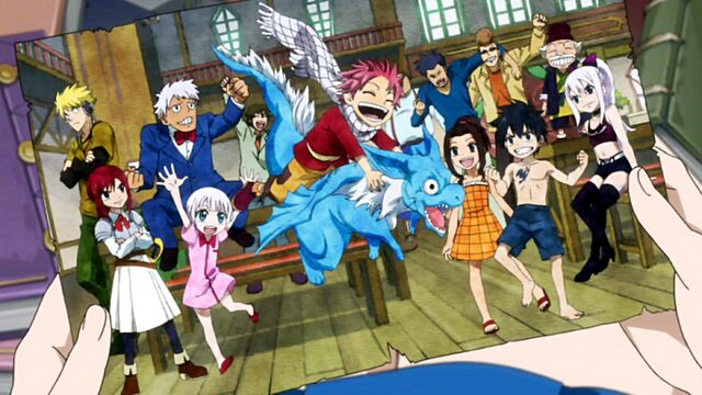 File:Lucy holding a picture of the young Fairy Tail Mages.jpg