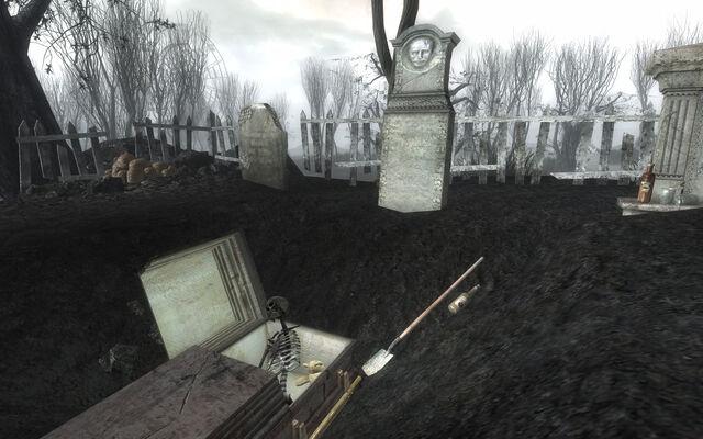 File:PL Ofie Clan Plot opened grave.jpg