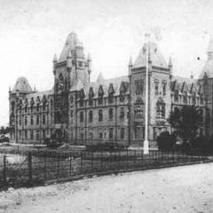 The General Hospital on the East Street Park, overlooking the park's main lake. The building was demolished in 1981 when its service was considered execrable, its size constricting, its location inconvenient and its resources limited. Although most of these could have been solved through new management, the council were very express that the building simply did not adhere to basic necessities, and thus was replaced by the new Blithebeth Hospital in the following year, which took the place of a 60's Sainsbury's.