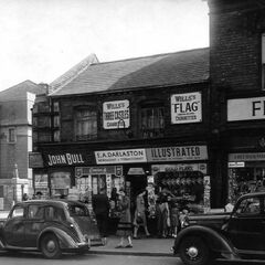 An old photo of Blossom Hill's characterful Jewellery St., with the Kingsway Cinema in the background.