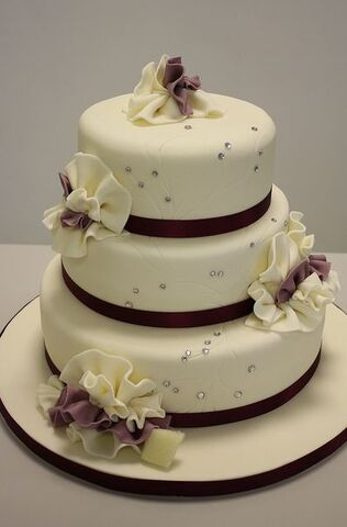 File:3 tier round elegant ivory wedding cake with ruffles and crystal beads.jpg