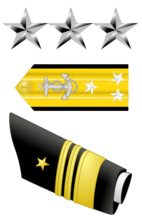 322px-US Navy O9 insignia svg